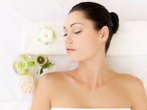 Relaxing woman at beauty spa salon royalty free stock photos