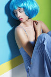 Relaxing Woman in Blue Wig Sleeping Stock Photography