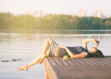Relaxing woman in city park near river Stock Image