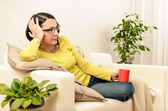 Relaxing woman cup tea coffee watching tv Stock Image