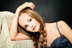 Relaxing Woman on Dark Background Royalty Free Stock Photos