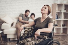 Relaxing Woman Disabled Soldier In A Wheelchair. Disabled Soldier Woman In Wheelchair Concept. Meeting After War. Son And Husband Background. Camouflage Uniform stock photography