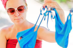 Woman dries blue bikini on clothesline Stock Photography