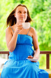 Young woman with cup of coffee Stock Photo