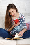 Relaxing woman sit comfortable on sofa Stock Images