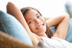 Relaxing woman sitting comfortable in sofa Stock Photos