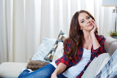 Relaxing woman sitting comfortable in sofa lounge Stock Photos