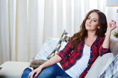 Relaxing woman sitting comfortable in sofa lounge Stock Photo
