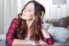 Relaxing woman sitting comfortable in sofa lounge Stock Images
