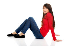 Relaxing woman sitting on the floor. Royalty Free Stock Images