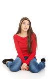 Relaxing woman sitting on the floor. Royalty Free Stock Photos