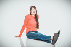 Relaxing woman sitting on the floor. Royalty Free Stock Photo