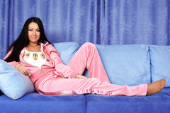 Relaxing woman in sofa Stock Photography