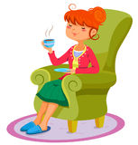 Relaxing woman. Woman relaxing on the sofa with a cup of hot drink Royalty Free Stock Photo