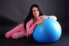 Relaxing woman in sport outfit Stock Images