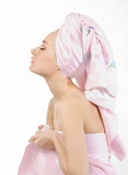 Relaxing woman with towel pink. Woman in profile with his eyes closed, dressed in a pink towel Royalty Free Stock Photo