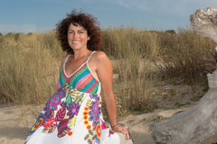 Relaxing woman wearing a sun dress on the beach Stock Photography
