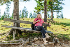 Relaxing woman on a wooden bench Stock Photos