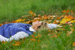 Relaxing women. The woman has a rest laying on a grass Stock Image