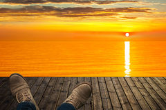 Relaxing on the wooden pier at sunrise Royalty Free Stock Image