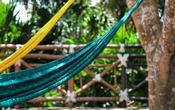 Relaxing with Yellow and Blue Hammocks in Riveria Maya, Mexico stock photos
