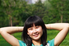 Relaxing young Asian beauty. With long hair Stock Photography