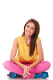 Relaxing young casual woman sitting down Royalty Free Stock Images