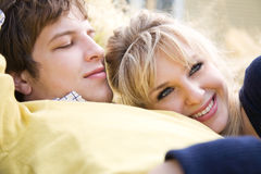 Relaxing young caucasian couple in love Royalty Free Stock Photos