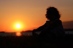Relaxing young child in sunset Royalty Free Stock Images