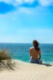 Relaxing. Young Girl Watching the Sea. Young girl watching the sea in Tarifa, Cadiz, Spain Stock Photography