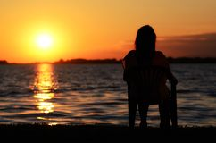 Relaxing young woman in sunset Stock Images