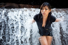 Relaxing young woman at waterfall Stock Photos