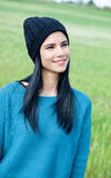 Relaxing young woman with wool cap Royalty Free Stock Photos