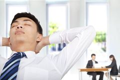 Relaxwd businessman in office royalty free stock photos