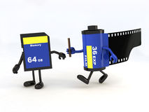 Relay between film photo roll and memory stick Royalty Free Stock Photos