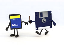 Relay between floppy disk and memory stick Stock Photography