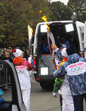 The relay of the Olympic Flame in Moscow Stock Photography