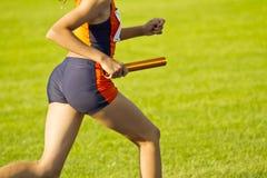 Relay race. Girls relay race green lawn Stock Photos