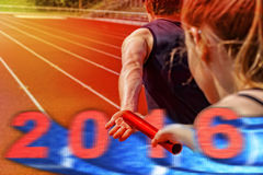 Relay race handing over 2016. Relay race athletes handing over the pole. Overlay of 2016 motion blurred date with 3d effect Royalty Free Stock Photography