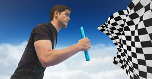Relay runner against clouds and blue sky and checkered flag. Digital composite of Relay runner against clouds and blue sky and checkered flag royalty free stock photos