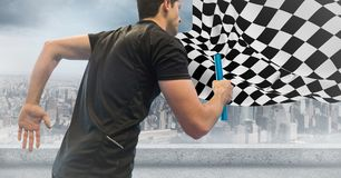Relay runner against skyline with flares and checkered flag. Digital composite of Relay runner against skyline with flares and checkered flag stock photo