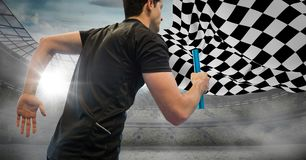 Relay runner against stadium with flares and checkered flag Royalty Free Stock Photos