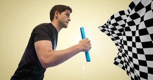 Relay runner against yellow background with flare and checkered flag Royalty Free Stock Photography