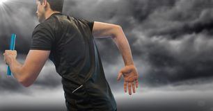Relay runner and flare against stormy sky Royalty Free Stock Photo