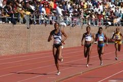 Relay runner leads the race. PHILADELPHIA, PA - APRIL 29: Hazel Clark runs the 800-meter anchor on April 29, 2006 she runs on USA Blue women's sprint medley on stock image