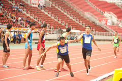 Relay in Thailand Open Athletic Championship 2013. PHATUMTANI,THAILAND – SEPTEMBER,6 : Groups of men player  action of  4 x 400 Relay in Thailand Open Stock Image