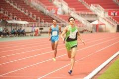 Relay in Thailand Open Athletic Championship 2013. PHATUMTANI,THAILAND – SEPTEMBER,6 : Groups of men player  action of  4 x 400 Relay in Thailand Open Stock Photos