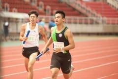 Relay in Thailand Open Athletic Championship 2013. PHATUMTANI,THAILAND – SEPTEMBER,6 : Groups of men player  action of  4 x 400 Relay in Thailand Open Royalty Free Stock Photo