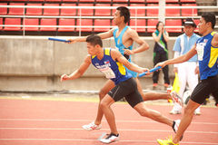 Relay in Thailand Open Athletic Championship 2013. PHATUMTANI,THAILAND – SEPTEMBER,6 : Groups of  player  action of  4 x 400 Relay in Thailand Open Athletic Royalty Free Stock Photo