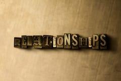 RELAZIONI - primo piano della parola composta annata grungy sul contesto del metallo Fotografia Stock Libera da Diritti